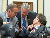 "United States Representative Mark Meadows (Republican of North Carolina), center, US Representative David Cicilline (Democrat of Rhode Island), left, and US Representative Jamie Raskin (Democrat of Maryland), right, discuss the Democrat's request to release the closed-door transcript of FBI Deputy Assistant Director Peter Strzok as testifies during a joint hearing of the United States House Committee on the Judiciary and the US House Committee on Oversight and Government Reform on ""Oversight of FBI and DOJ Actions Surrounding the 2016 Election"" on Capitol Hill in Washington, DC on Thursday, July 12, 2018. <br /> Credit: Ron Sachs / CNP<br /> (RESTRICTION: NO New York or New Jersey Newspapers or newspapers within a 75 mile radius of New York City)"