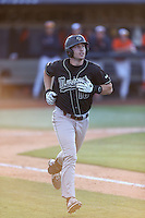 Brian Mundell (16) of the Cal Poly Mustangs runs to first base during a game against the Cal State Fullerton Titans at Goodwin Field on April 2, 2015 in Fullerton, California. Cal Poly defeated Cal State Fullerton, 5-0. (Larry Goren/Four Seam Images)