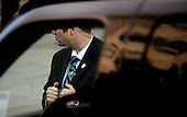 A United States Secret Service agent stands still during a Presidential motorcade October 1 , 2014 in Washington, DC. Julia Pierson, the director of the U.S. Secret Service, resigned Wednesday amid embarrassing new revelations of breaches to the protective cordon around U.S. President Barack Obama. <br /> Credit: Olivier Douliery / Pool via CNP