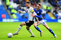 Matt Grimes of Swansea City battles with Gavin Whyte of Cardiff City during the Sky Bet Championship match between Cardiff City and Swansea City at the Cardiff City Stadium in Cardiff, Wales, UK. Sunday 12 January 2020