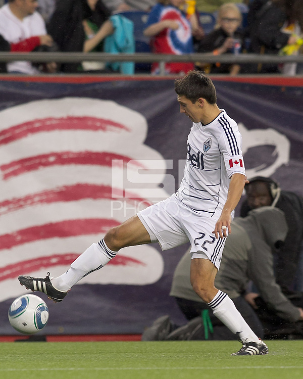 Vancouver Whitecaps FC midfielder Shea Salinas (22) traps the ball. In a Major League Soccer (MLS) match, the New England Revolution defeated the Vancouver Whitecaps FC, 1-0, at Gillette Stadium on May14, 2011.