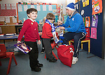 St Johnstone players took some festive cheer to Fairview School in Perth gving out selection boxes and gifts to the pupils&hellip;David Wotherspoon wraps a Saints scarf around primary school pupil Jack watched by fellow pupil Logan<br />