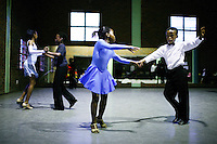 SOWETO, SOUTH AFRICA OCTOBER 25: Ballroom dancers rehearse in a community hall in Pimville Community center on October 25, 2006 in Soweto, Johannesburg, South Africa. Ballroom dancing is very popular sport in the township and all over the country. Soweto is South Africa's largest township and it was founded about one hundred years to make housing available for black people south west of downtown Johannesburg. The estimated population is between 2-3 million. Many key events during the Apartheid struggle unfolded here, and the most known is the student uprisings in June 1976, where thousands of students took to the streets to protest after being forced to study the Afrikaans language at school. Soweto today is a mix of old housing and newly constructed townhouses. A new hungry black middle-class is growing steadily. Many residents work in Johannesburg, but the last years many shopping malls have been built, and people are starting to spend their money in Soweto. (Photo by Per-Anders Pettersson)
