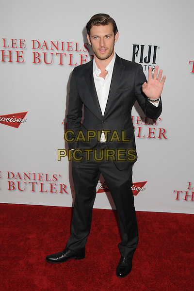 Alex Pettyfer<br /> &quot;Lee Daniels' The Butler&quot; Los Angeles Premiere held at Regal Cinemas L.A. Live, Los Angeles, California, USA.<br /> August 12th, 2013<br /> full length white shirt black suit grey gray stubble facial hair hand palm arm waving <br /> CAP/ADM/BP<br /> &copy;Byron Purvis/AdMedia/Capital Pictures