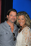 "General Hospital Laura Wright ""Carly"" poses with her husband John Wright at a Wine Tasting for Standing Sun Wines on August 11, 2012 at MaGooby's Joke House in Timonium, Maryland. The fans got a chance to takes all the various wines, a Q&A, photos, autographs. L(Photo by Sue Coflin/Max Photos)"