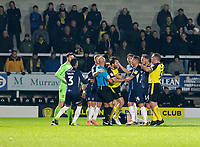 3rd December 2019; Pirelli Stadium, Burton Upon Trent, Staffordshire, England; English League One Football, Burton Albion versus Southend United; Referee Darren Drysdale pulls off John-Joe O'Toole of Burton Albion as the players get in a fight after a tackle on Tom Hopper of Southend United  - Strictly Editorial Use Only. No use with unauthorized audio, video, data, fixture lists, club/league logos or 'live' services. Online in-match use limited to 120 images, no video emulation. No use in betting, games or single club/league/player publications