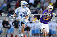 Baltimore, MD - April 5: Defensemen Eric Cantor # 28 of the Albany Great Dane's defends Midfielder Lee Coppersmith #16 of the John Hopkins Blue Jays player during the Albany v Johns Hopkins mens lacrosse game at  Homewood Field on April 5, 2012 in Baltimore, MD. (Ryan Lasek/Eclipse Sportwire)