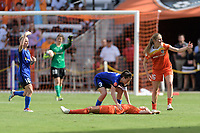 Houston, TX - Saturday May 27, 2017: Lauren Barnes (3) of the Seattle Reign FC and Janine Beckie (16) of the Houston Dash wave for medical help for Rachel Daly (3) of the Houston Dash after she collapses from heat just as the game ends during a regular season National Women's Soccer League (NWSL) match between the Houston Dash and the Seattle Reign FC at BBVA Compass Stadium.