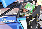 BRANDON, SD - MAY 12:  NASCAR's Kyle Larson sits in the car his is racing prior to hot laps Sunday night at Huset's Speedway in Brandon.  (Photo by Dave Eggen/Inertia)