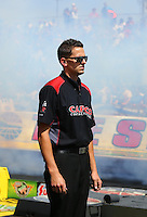 Apr 11, 2015; Las Vegas, NV, USA; A crew member waits in his position for NHRA top fuel driver Steve Torrence to do his burnout during qualifying for the Summitracing.com Nationals at The Strip at Las Vegas Motor Speedway. Mandatory Credit: Mark J. Rebilas-