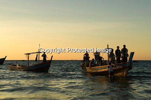 Fisgerman going night fishing Ngapali Beach. Burma Myanmar  2008