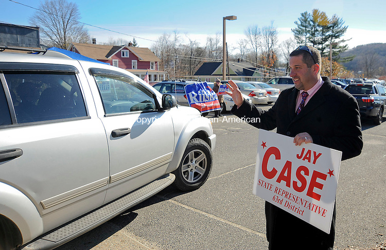 WINSTED, CT-06 NOVEMBER 2012--110612JS02- Jay Case, Republican candidate for the 63rd District waves as voters inter the parking lot Tuesday at Pearson Middle School in Winsted..Jim Shannon Republican-American