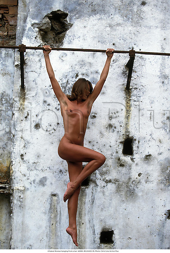 A Naked Woman hanging from a bar. MODEL RELEASED. 95. Photo: Chris Cole/Action Plus...1995.physique fitness recreation nude release lifestyle