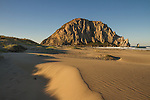 Early morning sun sweeps across the Morro Strand State Beach.