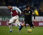 Aaron Lennon of Burnley tackles David Silva of Manchester City during the Premier League match at Turf Moor, Burnley. Picture date: 3rd December 2019. Picture credit should read: Simon Bellis/Sportimage