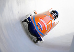 15 December 2007: Netherlands 1 pilot Edwin Van Calker with brakeman Sybren Jansma exit a turn during their first run at the FIBT World Cup Bobsled Competition at the Olympic Sports Complex on Mount Van Hoevenberg, at Lake Placid, New York, USA. ..Mandatory Photo Credit: Ed Wolfstein Photo