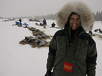 Wells Fargo Teacher on the Trail, Terrie Hanke takes in the scenes at the Nikolai checkpoint