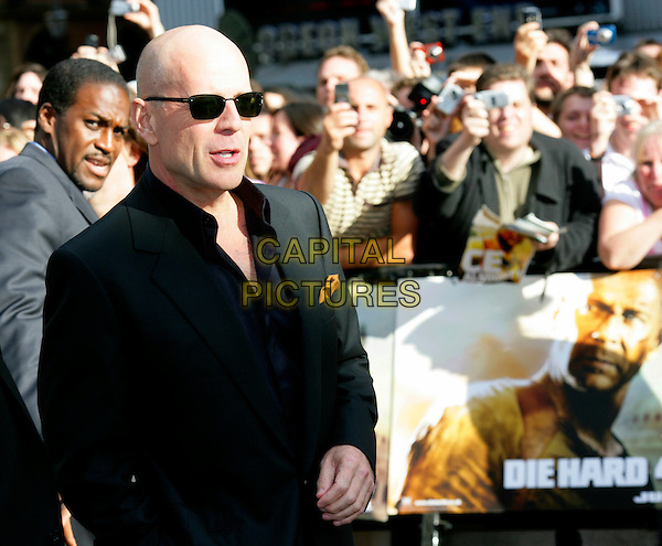 "BRUCE WILLIS .Leaving the UK premiere of ""Die Hard 4.0: Live Free or Die Hard"" at the Empire Leicester Square, London, England..June 20th, 2007.half length black suit  jacket sunglasses shades.CAP/CAM.©Andre Camara/Capital Pictures"