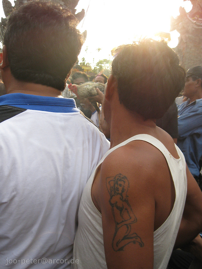 villagers with tatoo watching cock fight in viilage Bangli, central Bali, archipelago Indonesia