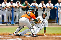 May 31, 2009:  NCAA Division 1 Gainesville Regional:    Miami Catcher Yasmani Grandal (24) tags out Jacksonville LF Kyle Fleming (16) during 2nd round regional action at Alfred A. McKethan Stadium on the campus of University of Florida in Gainesville.  Miami Hurricanes eliminated Jacksonville 4-0 and will advance to the finals against Florida............