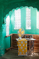 The green washed walls of the Tiwiri haveli are the perfect backdrop for a vintage sewing machine