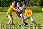 Mike McCarthy Currow goes past Pat O'Sullivan and Damien O'Sullivan Gneeveguilla during their KCL D3 clash in Currow on Sunday
