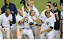 Ichiro Suzuki (Yankees),<br /> JUNE 25, 2013 - MLB :<br /> Ichiro Suzuki of the New York Yankees celebrates with his teammates at home plate after hitting a walk off home run in the ninth inning during the Major League Baseball game against the Texas Rangers at Yankee Stadium in The Bronx, New York, United States. (Photo by AFLO)