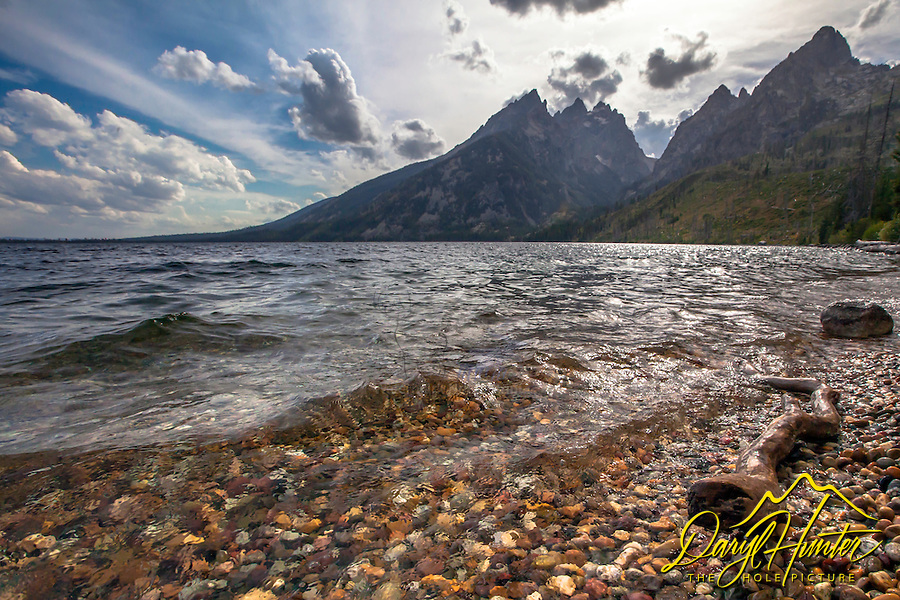 The Grand Tetons from North Jenny Lake on a windy afternoon. The cathedral group is the prominent formation here consisting of the Grand Teton, Mt. Teewinot, and Mt. Owen.  Mt St. John is on the right.