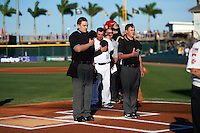 Umpires Dave Attridge (left) and Jordan Johnson (right) during the national anthem before a Bradenton Marauders game against the Fort Myers Miracle on April 9, 2016 at McKechnie Field in Bradenton, Florida.  Fort Myers defeated Bradenton 5-1.  (Mike Janes/Four Seam Images)