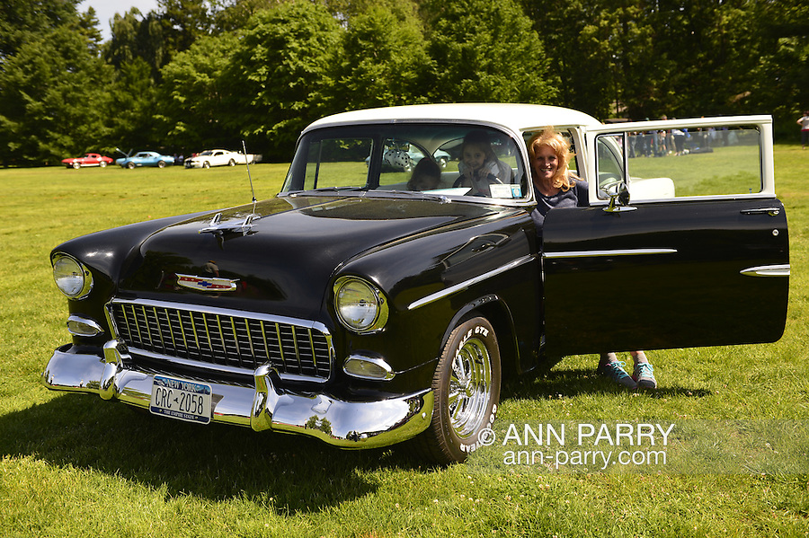 Old Westbury, New York, U.S. - June 1, 2014 - A black and white 1955 Chevrolet Belair, owned by PETER VENZA of WOODHAVEN, is an entry at the Antique and Collectible Auto Show held on the historic grounds of elegant Old Westbury Gardens in Long Island, and sponsored by Greater New York Region AACA Antique Automobile Club of America.