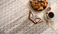 Francois, a waterjet mosaic shown in honed Carrara, Dolomite, and Paperwhite, is part of the Illusions® collection by Sara Baldwin for New Ravenna.