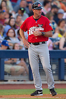 Frisco RoughRiders manager Jason Wood (40) coaching third base during the Texas League game against the Tulsa Drillers at ONEOK field on August 15, 2014 in Tulsa, Oklahoma  The RoughRiders defeated the Drillers 8-2.  (William Purnell/Four Seam Images)