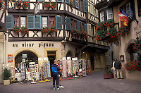 AJ2131, Alsace, France, Europe, Colmar, Haut Rhin, People shopping in the city of Colmar, capital of Haut Rhin, with its half-timbered houses (Alsatian-style buildings) with flowers in window boxes that line the narrow streets in downtown Colmar.