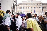 Roma, 24 Maggio 2011.Piazza Montecitorio.Presidio per i Referendum.Al termine del voto di Fiducia l'ex ministro Andrea Ronchi padre della legge sulla privatizzazione dell'acqua e il deputato Adolfo Urso passano nel presidio e vengono contestati.