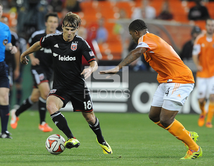 Washington D.C. - May 17, 2014: Chris Rolfe (18) of D.C. United goes against Jermaine Taylor (4) of Houston Dynamo.  D.C. United defeated  the Houston Dynamo 2-0 during a Major League Soccer match for the 2014 season at RFK Stadium.