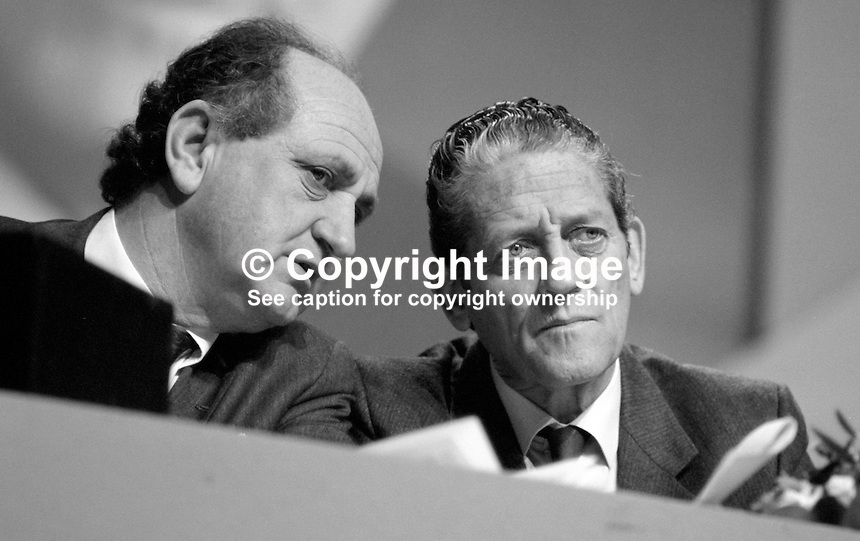 Gerry Collins, TD, Minister for Justice, left, talking with Brian Lenihan, TD, Minister for Foreign Affairs, on platform at Fianna Fail Ard Fheis, 19880203GC+BL.<br /> <br /> Copyright Image from Victor Patterson,<br /> 54 Dorchester Park, <br /> Belfast, UK, BT9 6RJ<br /> <br /> t1: +44 28 9066 1296 (from Rep of Ireland 048 9066 1296)<br /> t2: +44 28 9002 2446 (from Rep of Ireland 048 9002 2446)<br /> <br /> m: +44 7802 353836<br /> <br /> e: victorpatterson@me.com<br /> www.victorpatterson.com<br /> <br /> Please see my Terms and Conditions of Use at www.victorpatterson.com. It is IMPORTANT that you familiarise yourself with them.<br /> <br /> Images used on the Internet must be visibly watermarked i.e. &copy; Victor Patterson<br /> within the body of the image and copyright metadata must not be deleted. Images <br /> used on the Internet have a size restriction of 4kbs and will be chargeable at current<br />  NUJ rates unless agreed otherwise.<br /> <br /> This image is only available for the use of the download recipient i.e. television station, newspaper, magazine, book publisher, etc, and must not be passed on to any third <br /> party. It is also downloaded on condition that each and every usage is notified within 7 days to victorpatterson@me.com<br /> <br /> The right of Victor Patterson to be identified as the author is asserted in accordance with The Copyright Designs And Patents Act (1988). All moral rights are asserted.