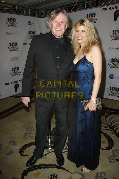 GARY BUSEY & GUEST .21st Annual Night of 100 Stars Awards Gala Celebrating the 83rd Annual Academy Awards Held at The Beverly Hills Hotel,  Beverly Hills, California, USA, 27th February 2011..full length black suit tie blue dress .CAP/ADM/TB.©Tommaso Boddi/AdMedia/Capital Pictures.