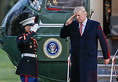 United States President Donald J. Trump (R) salutes as he disembarks Marine One on the South Lawn of the White House in Washington, DC, USA, 05 March 2017. Trump returned to Washington from a weekend at his Palm Beach. Florida, Mar-a-Lago club.<br /> Credit: Erik S. Lesser / Pool via CNP