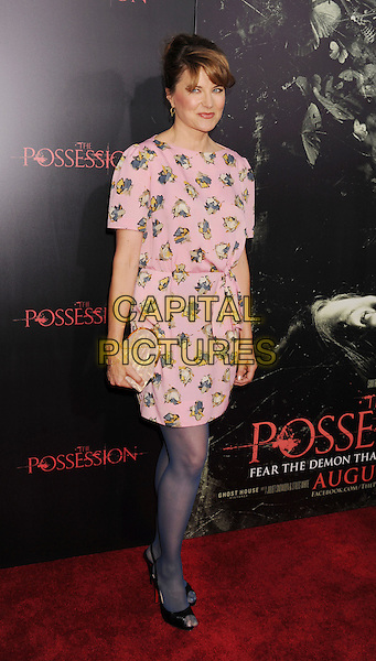 "Lucy Lawless.""The Possession"" Los Angeles Premiere held at Arclight Cinemas, Hollywood, California, USA..August 28th, 2012.full length dress blue tights black peep toe shoes pink blue yellow print dress .CAP/ROT/TM.©Tony Michaels/Roth Stock/Capital Pictures"