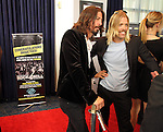 LOS ANGELES, CA - APRIL 18:  Dave Grohl and Taylor Hawkins from Foo Fighters talk to the media at the 2013 Rock and Roll Hall of Fame Induction Ceremony at the Nokia Theatre in Los Angeles, CA. (Photo by Dave Eggen/Inertia)
