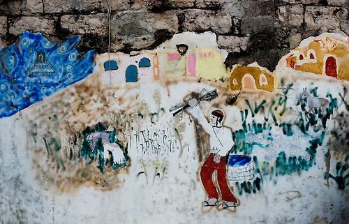 mural in tel rumeida Hebron, made by settlers (a young jewish settler id harrassing palestinian farmers) Peintrue mural réalisée par les colons de Hebron (la peinture représente un jeune colon juif intimidant des paysans palestiniens)