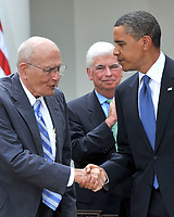 Washington, D.C. - June 22, 2009 -- United States President Barack Obama, right, shakes hands with U.S. Representative John Dingell (Democrat of Michigan), left, after signing the Family Smoking Prevention and Tobacco Control Act in the Rose Garden of the White House on Monday, June 22, 2009.  U.S. Senator Chris Dodd (Democrat of Connecticut) looks on from center. Credit: Ron Sachs/CNP/AdMedia