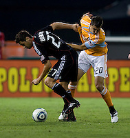 Branko Boskovic (27) of DC United takes the ball away from Geoff Cameron (20) of the Houston Dynamo during their game at RFK Stadium in Washington, DC.  Houston defeated D.C. United, 3-1.
