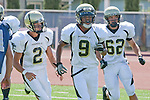 Torrance, CA 09/08/11 - Ian Escutia (Peninsula #2), Jordan Gates (Peninsula #9) and Noah Stettler (Peninsula #62) in action during the North-Peninsula Junior Varsity Football game at North High School in Torrance.