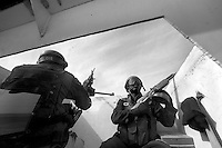 Private security operators from the British company ArmorGroup escort a supply convoy near Al Asad air base on October 18, 2006.  The coalition forces and civilian administration in Iraq depend heavily on thousands of controversial security contractors to support their reconstruction efforts and military operations.