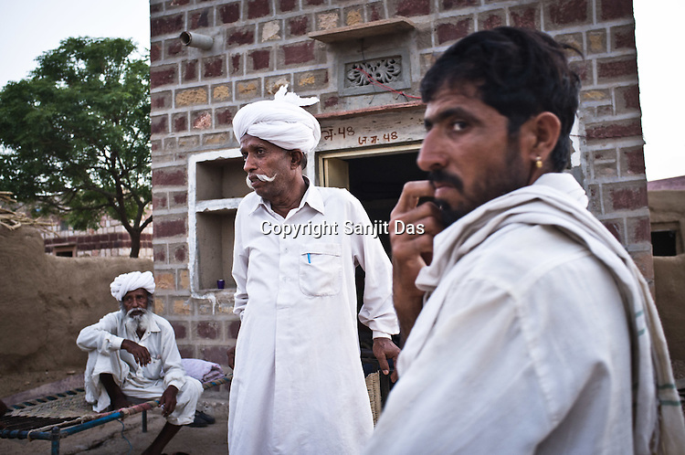 66-year-old Manganiyar artist, Lakha Khan speaks to local villagers outside his house in Raneri village of Jodhpur district in Rajasthan, India. Photo: Sanjit Das/Panos