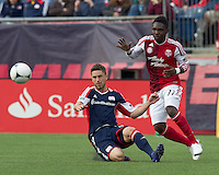 New England Revolution midfielder/defender Chris Tierney (8) slides to intercept pass to Portland Timbers midfielder Kalif Alhassan (11). In a Major League Soccer (MLS) match, the New England Revolution defeated Portland Timbers, 1-0, at Gillette Stadium on March 24, 2012