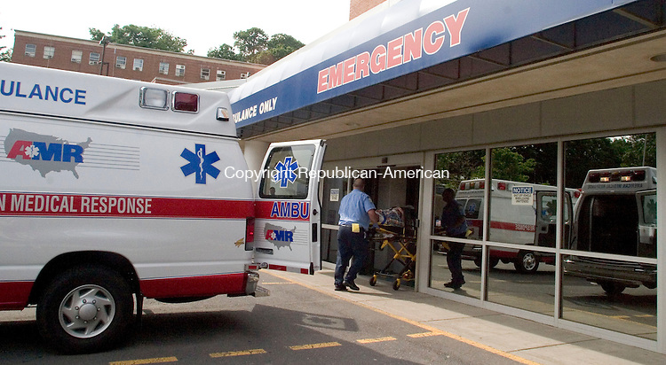 WATERBURY, CT -16 JUNE 06- 061606JT01-<br /> Emergency response workers wheel in a new patient to the emergency room at Waterbury Hospital on Friday afternoon.<br /> Josalee Thrift Republican-American