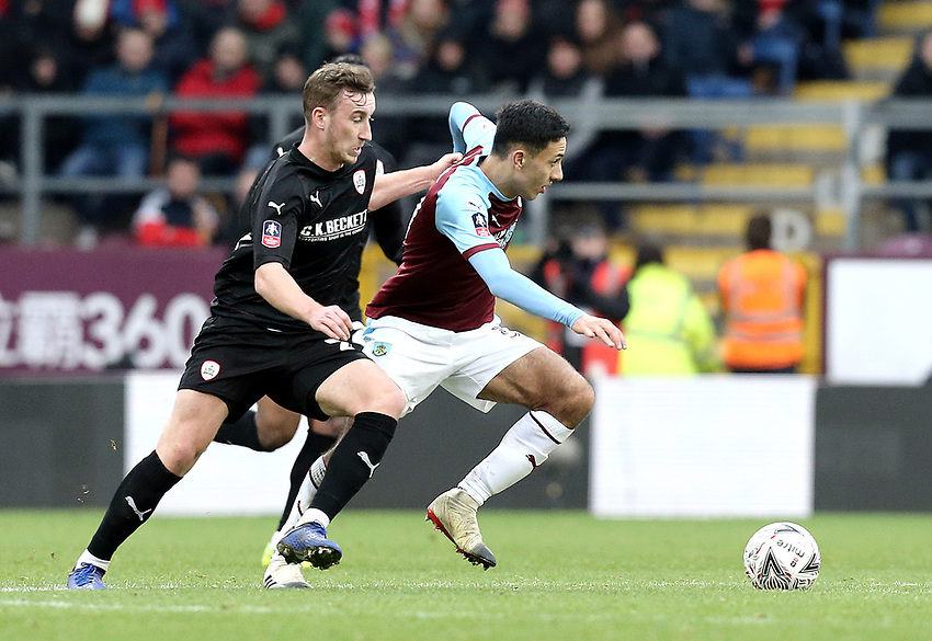 Burnley's Dwight McNeil under pressure from Barnsley's Mike Bahre<br /> <br /> Photographer Rich Linley/CameraSport<br /> <br /> Emirates FA Cup Third Round - Burnley v Barnsley - Saturday 5th January 2019 - Turf Moor - Burnley<br />  <br /> World Copyright © 2019 CameraSport. All rights reserved. 43 Linden Ave. Countesthorpe. Leicester. England. LE8 5PG - Tel: +44 (0) 116 277 4147 - admin@camerasport.com - www.camerasport.com
