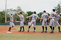 Edgewood Eagles right fielder Adam Cairo (3) high fives Ryan Fields (9) after making a play during the second game of a double header against the Bethel Wildcats on March 15, 2019 at Terry Park in Fort Myers, Florida.  Bethel defeated Edgewood 3-2.  Also shown, Connor Schatzberg (11), Casey Willis (10), Kyle Semrad (36) high fiveing Bryan Sternig (right).  (Mike Janes/Four Seam Images)